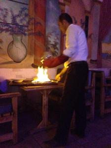 Nate's fancy dinner, cooked in a flaming clay pot.  Kind of awesome!