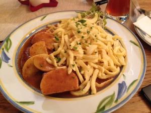Pork, slices apples, spaetzel, and gravy.  I LOVE GERMAN FOOD