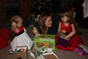 Opening early Christmas presents with the girls (Yes, I bought them food.  It's their favorite thing!)